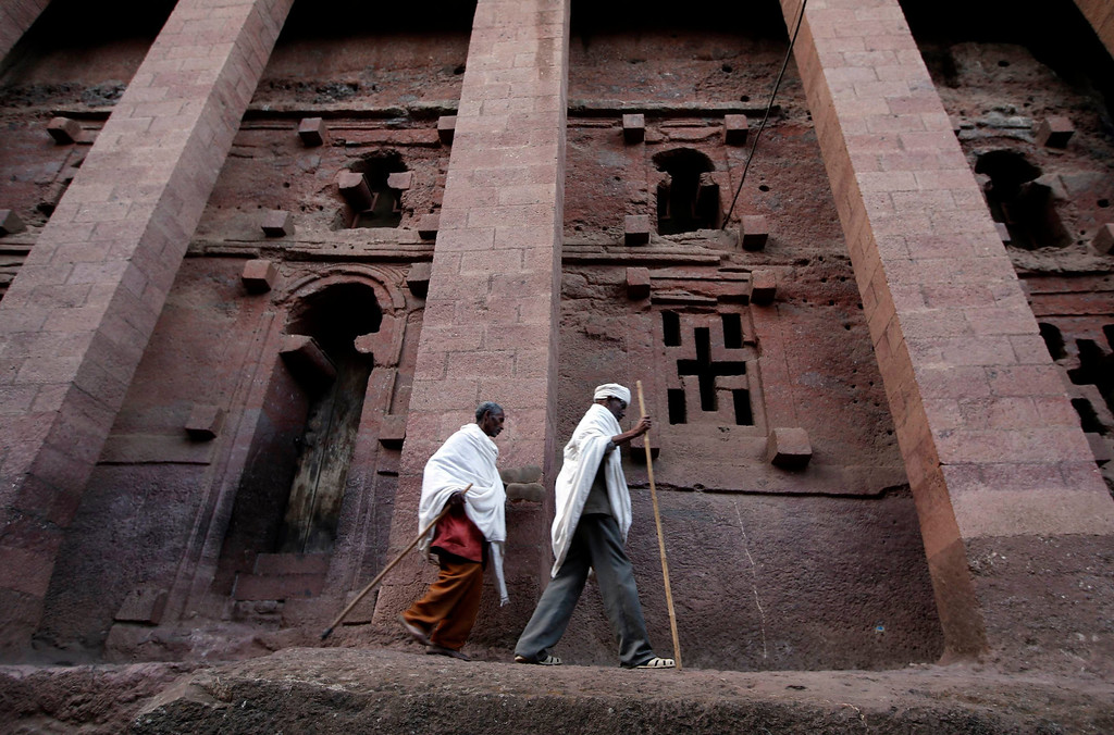 . Orthodox Christians walk in front of the famous monolithic rock-cut churches during a Good Friday celebration in Lalibela May 3, 2013.  REUTERS/ Goran Tomasevic