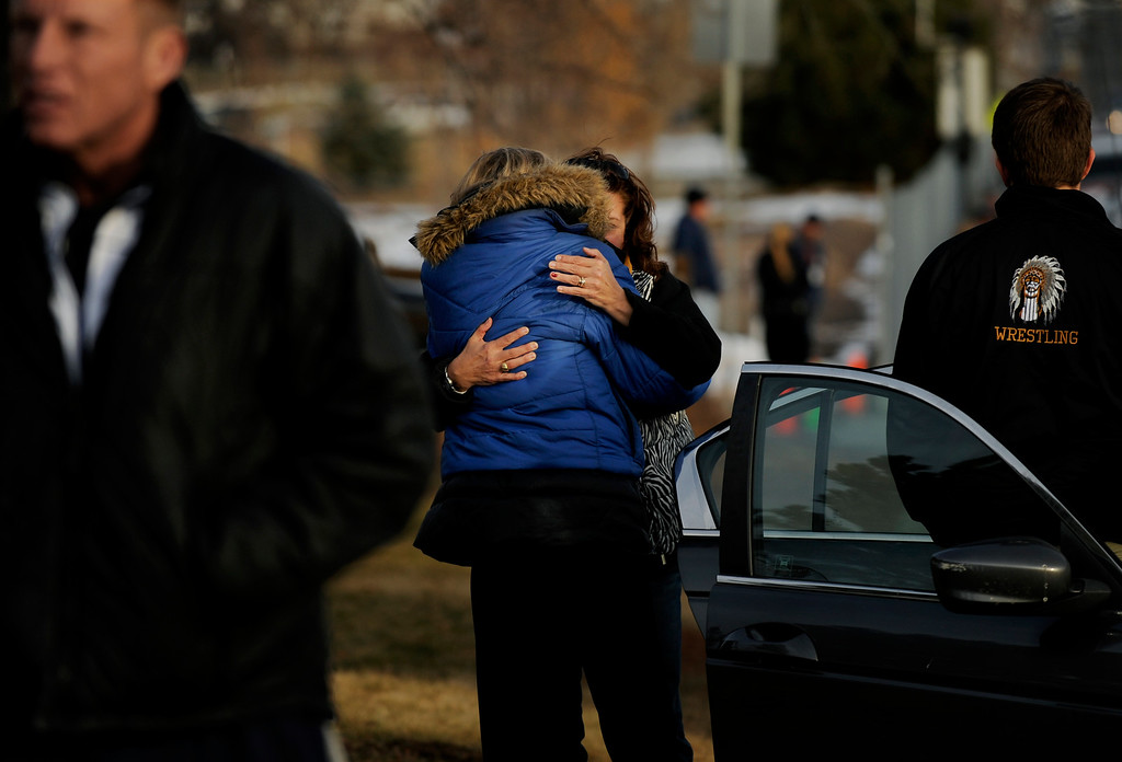 . Parents and guardians of Arapahoe High School (AHS) students fled to Euclid Middle School (EMS) on Dec. 13 after a lone gunman - a senior at Arapahoe High School - entered the high school and fired gunshots, wounding three people and then killing himself. AHS students were transferred to Euclid Middle School after the shooting. Photo by Jamie Cotten, Special to The Denver Post