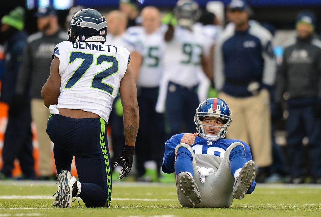 . Quarterback Eli Manning #10 of the New York Giants on the ground after being hit on a throw during the 2nd half of the Seattle Seahawks 23-0 win over the New York Giants at MetLife Stadium on December 15, 2013 in East Rutherford, New Jersey. (Photo by Ron Antonelli/Getty Images)