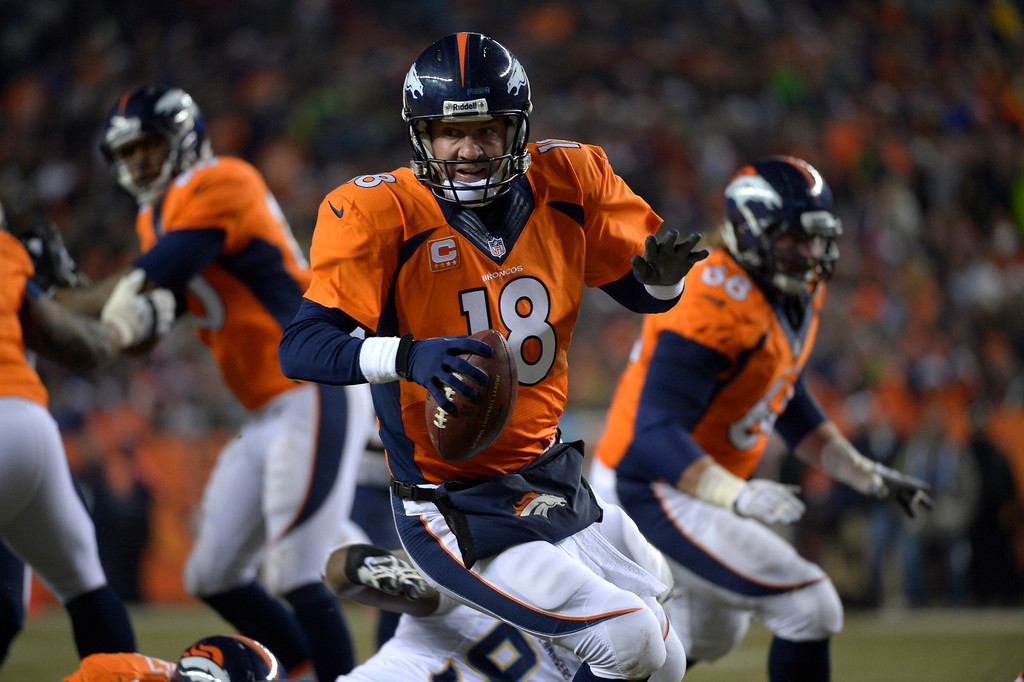 . DENVER, CO - DECEMBER 12: Denver Broncos quarterback Peyton Manning (18) scrambling during the second quarter. The Denver Broncos vs. the San Diego Chargers at Sports Authority Field at Mile High in Denver on December 12, 2013. (Photo by Joe Amon/The Denver Post)