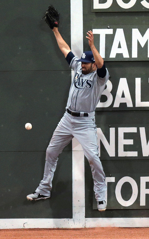 . Tampa Bay Rays left fielder David DeJesus can\'t catch a ball hit by Boston Red Sox\'s Stephen Drew, against the Green Monster scoreboard in the fourth inning of Game 2 of baseball\'s American League division series Saturday, Oct. 5, 2013, in Boston. Drew tripled. (AP Photo/Charles Krupa)