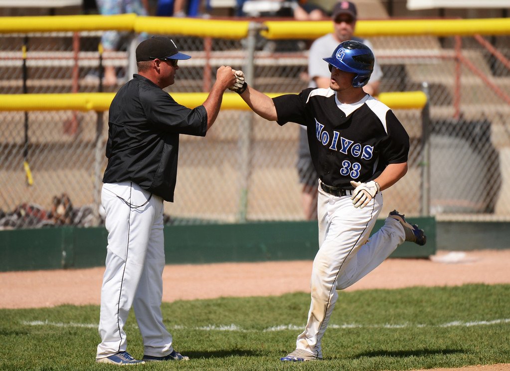 . DENVER, CO. - MAY 17 : Reece Weber of Grandview High School (33) celebrates his home run with the coach during the 5A playoff game against Rocky Mountain High School at All City Field. Denver, Colorado. Grandview won 9-2. May 17, 2013. (Photo By Hyoung Chang/The Denver Post)