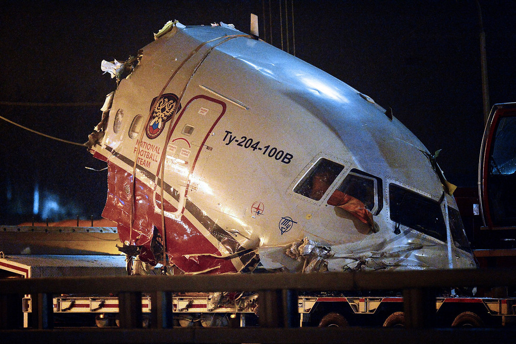. A truck removes the cabin of the Tu-204 jet from its crash site near the Vnukovo airport outside Moscow on December 29, 2012. Four crew were killed when a Russian airliner crashed into a motorway and broke up into three pieces after overshooting the runway at an international Moscow airport. The Red Wings airlines Russian-made Tu-204 jet -- empty of passengers and carrying just its eight crew on a return trip from the Czech Republic -- caught fire after crashing through the perimeter fence of Vnukovo airport in the west of the city.  NATALIA KOLESNIKOVA/AFP/Getty Images