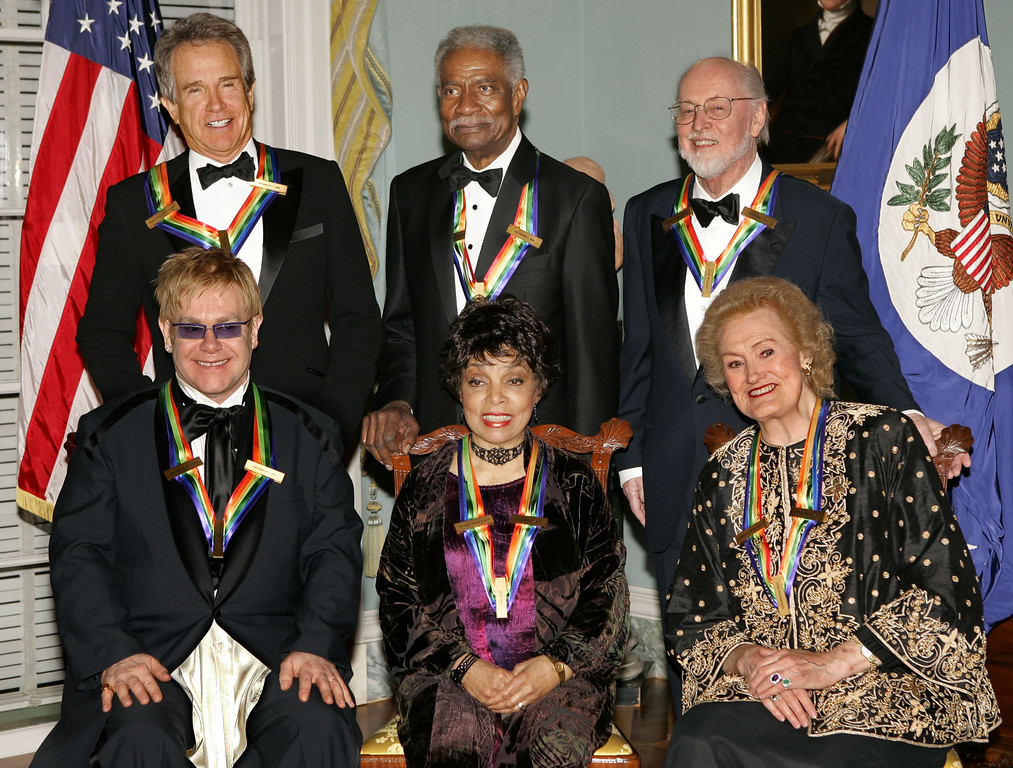 . Recipients of the 27th annual Kennedy Center Honors pose for a group photo following a dinner celebrating their lifetime achievements in the arts, at the State Department in Washington, Saturday, Dec. 4, 2004. From left to right in front are: singer and composer Elton John; actress Ruby Dee; and soprano Joan Sutherland. Standing at rear, left to right are: actor, producer, writer and director Warren Beatty; actor, writer and producer Ossie Davis; and composer and conductor John Williams. (AP Photo/J. Scott Applewhite)