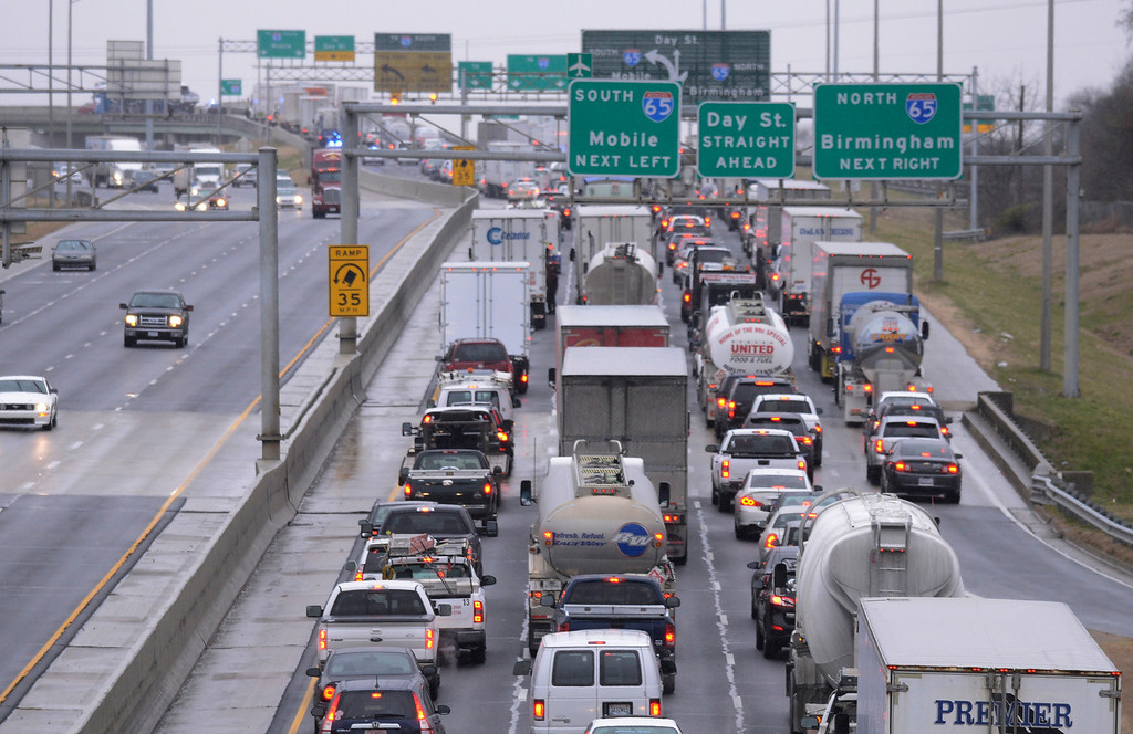 . Traffic on I-85 South is at a standstill after the ramps onto I-85 started icing over due to freezing rain on Tuesday, Jan. 28, 2014, in Montgomery, Ala.   (AP Photo/Montgomery Advertiser, Lloyd Gallman)