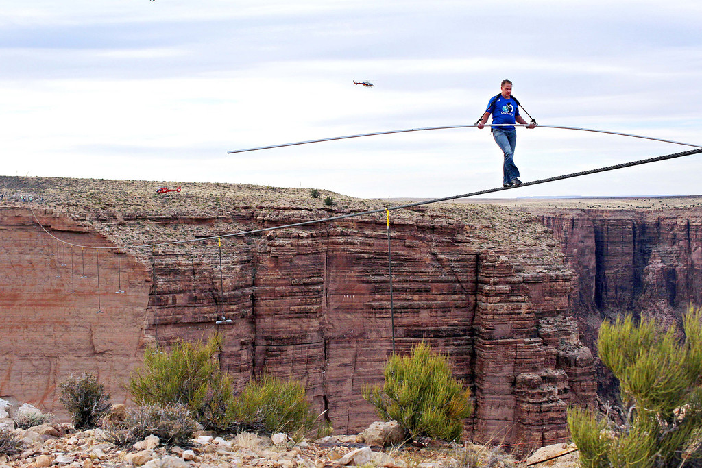 . Aerialist Nik Wallenda nears the end of his quarter mile walk over the Little Colorado River Gorge in northeastern Arizona on Sunday, June 23, 2013. The daredevil successfully traversed the tightrope strung 1,500 feet above the chasm near the Grand Canyon in just more than 22 minutes, pausing and crouching twice as winds whipped around him and the cable swayed. (AP Photos/Discovery Channel, Tiffany Brown)