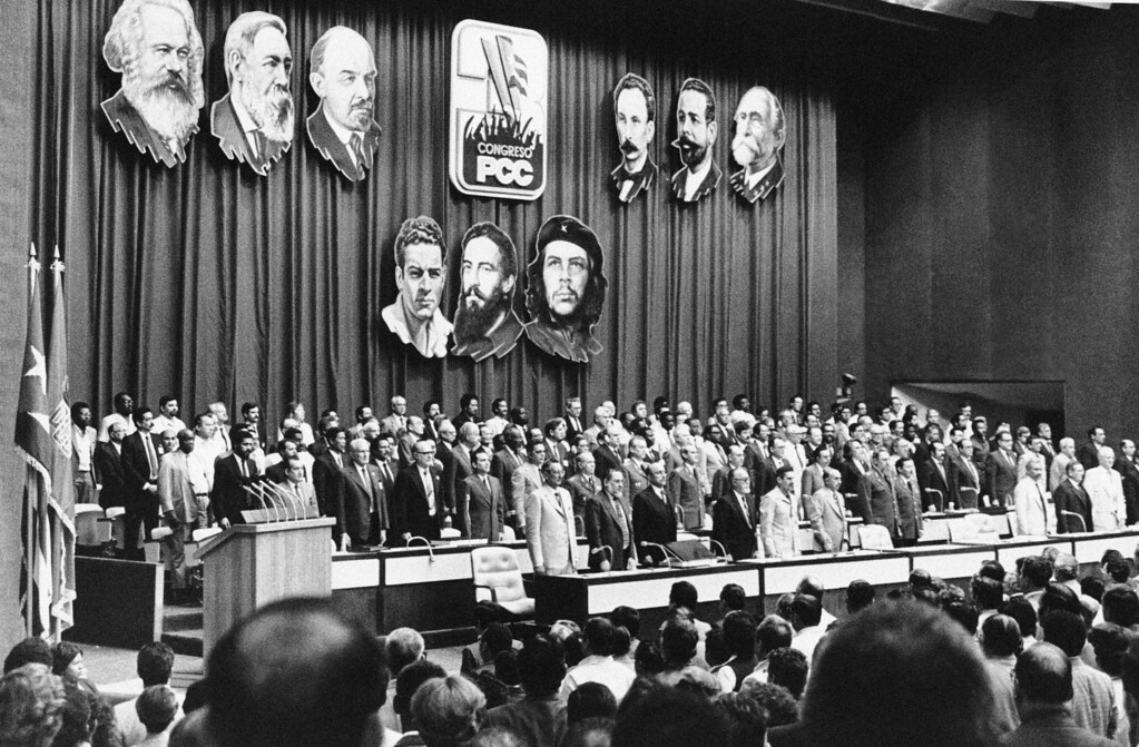 . 1700 Cuban communists, and 200 foreign delegates in Havana\'s conventional palace on Feb. 4, 1986, took part in the inauguration of the third party congress to hear the presentation of a report by President Fidel Castro. Stage decorated paintings of: Marx-Engels-Lenin, Marti- Maceo-Gomez, cuban patriots, and Mella-Cienfuegos-Che Guevara, heroes of the Castro revolution. (AP Photo/Charles Tasnadi)