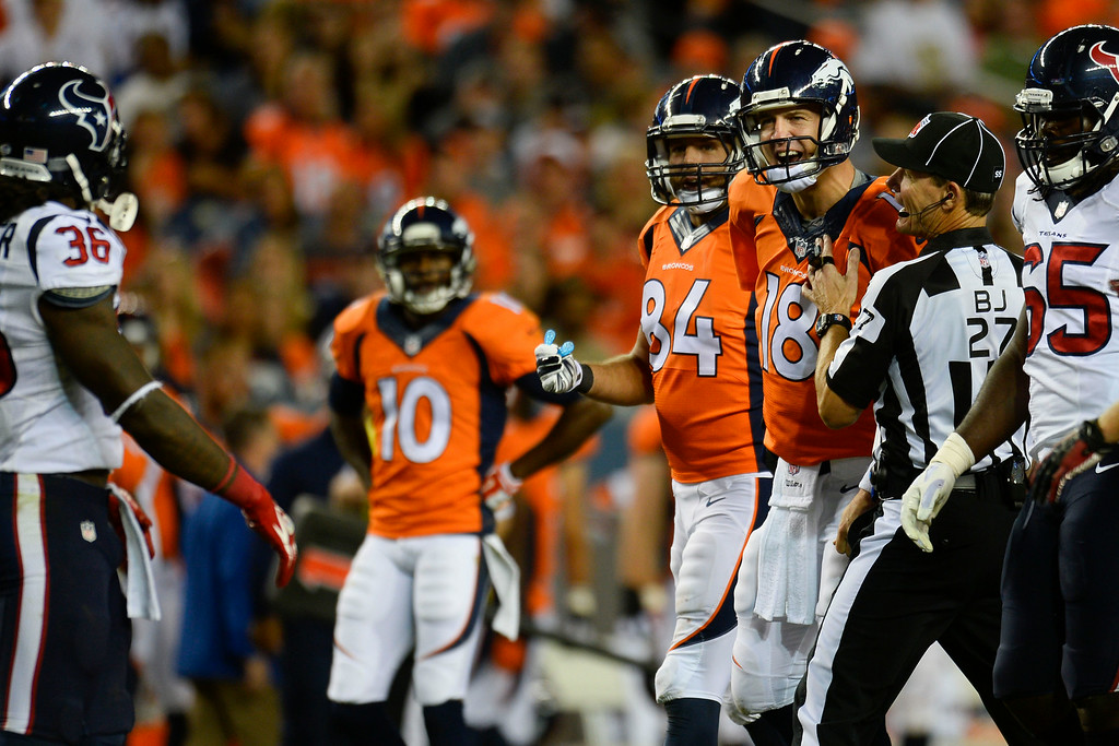 . DENVER, CO - AUGUST 23:  Peyton Manning (18) of the Denver Broncos shouts at D.J. Swearinger (36) of the Houston Texans after a play where Wes Welker (83) of the Denver Broncos was hit hard during a preseason football game at Sports Authority Field at Mile High on Saturday, August 23, 2014 in Denver, Colorado.  (Photo by Kent Nishimura/The Denver Post)