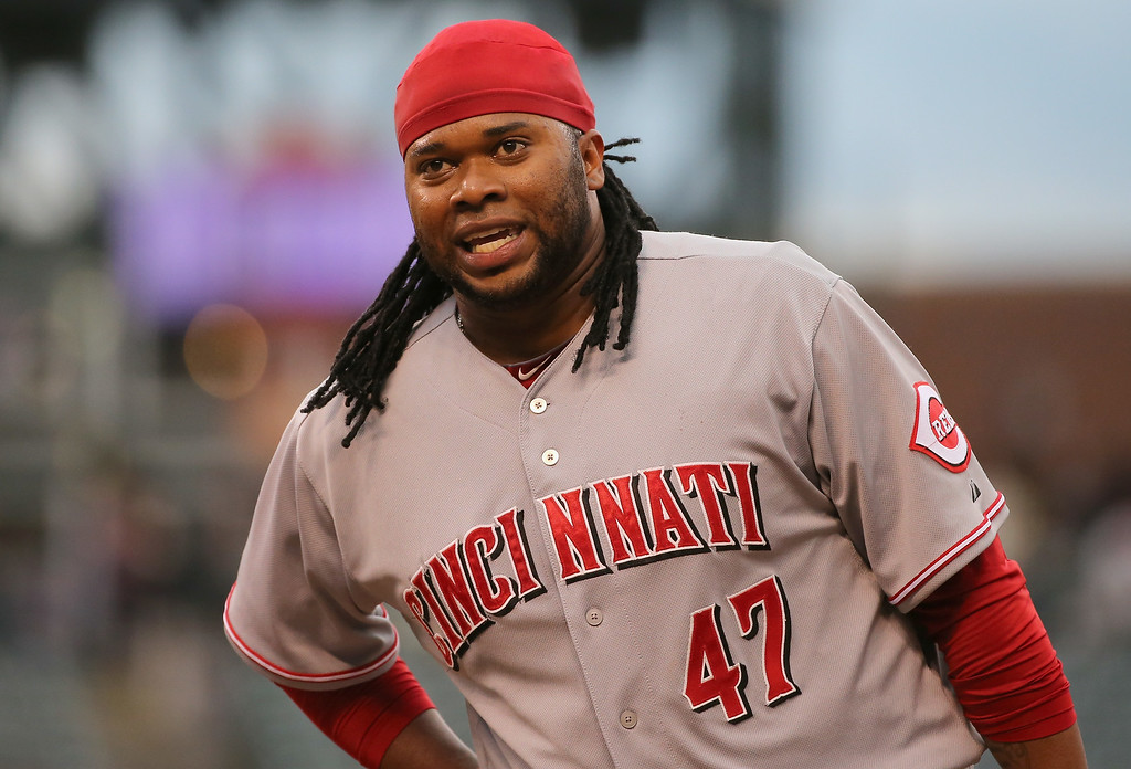 . DENVER, CO - AUGUST 15:  Johnny Cueto #47 of the Cincinnati Reds looks on from first base after hitting a single off of Matt Belisle #34 of the Colorado Rockies in the third inning at Coors Field on August 15, 2014 in Denver, Colorado.  (Photo by Doug Pensinger/Getty Images)