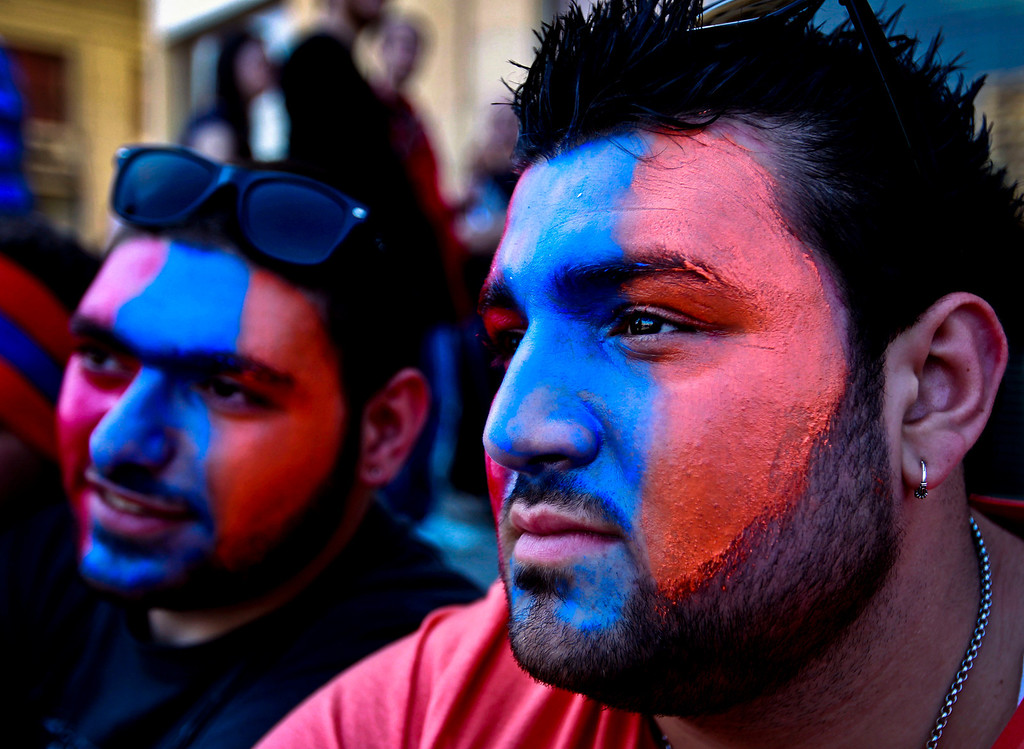 . Lebanese Armenian men, their faces painted with colors of the Armenian flag, attend a rally marking the 98th anniversary of massacres on thousands of Armenians, in Beirut, Lebanon, Wednesday, April 24, 2013. Armenian communities around the world mark the killing of up to 1.5 million Armenians, on April 24 each year with marches, vigils and rallies to demand recognition from the world community, and reparations from Turkey. Turkey claims the number of deaths is inflated and says the victims were killed in civil unrest. (AP Photo/Bilal Hussein)