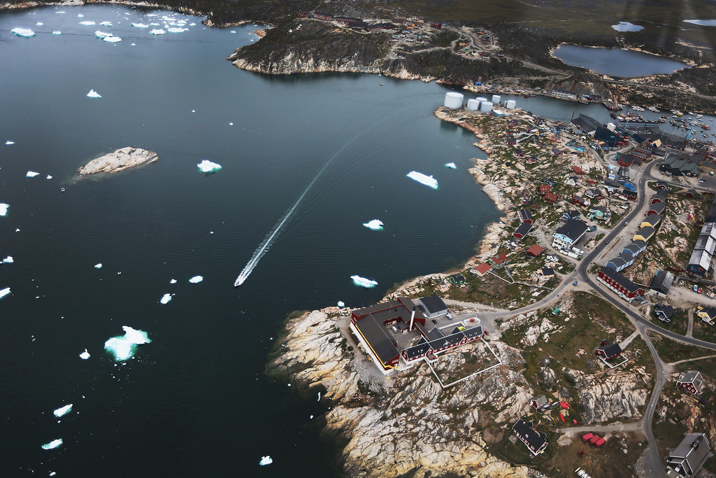 . Icebergs float in the water near the shore on July 17, 2013 in Ilulissat, Greenland.  (Photo by Joe Raedle/Getty Images)