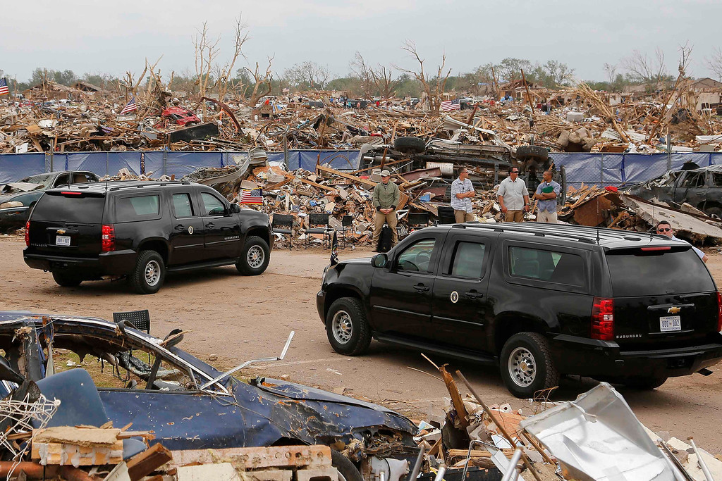 . U.S. President Barack Obama\'s motorcade waits amidst tornado rubble as he tours storm damage in Moore, Oklahoma, May 26, 2013. Nearly one week ago a monster tornado ravaged the town, killing 24 people.  REUTERS/Jonathan Ernst