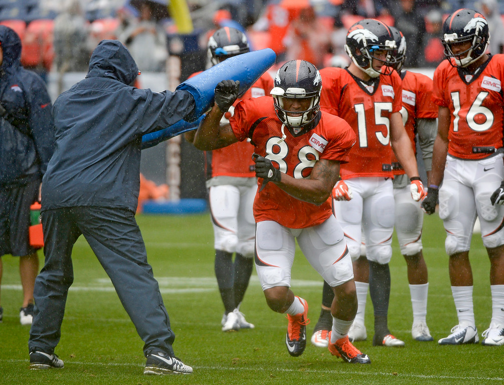. Denver Broncos wide receiver Demaryius Thomas (88) runs through drills during a rain day on day six of the Denver Broncos 2014 training camp July 30, 2014 at Sports Authority Field at Mile High Stadium.  (Photo by John Leyba/The Denver Post)