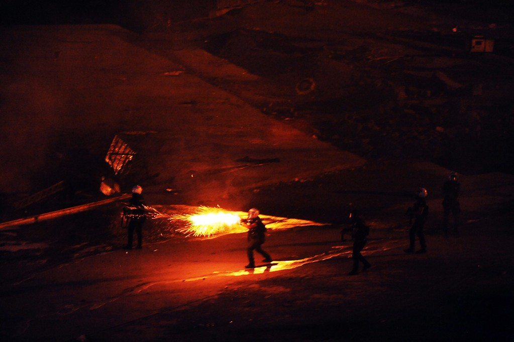 . People set fire as they clash with Turkish riot policemen on June 11, 2013.  AFP PHOTO /GURCAN  OZTURK/AFP/Getty Images