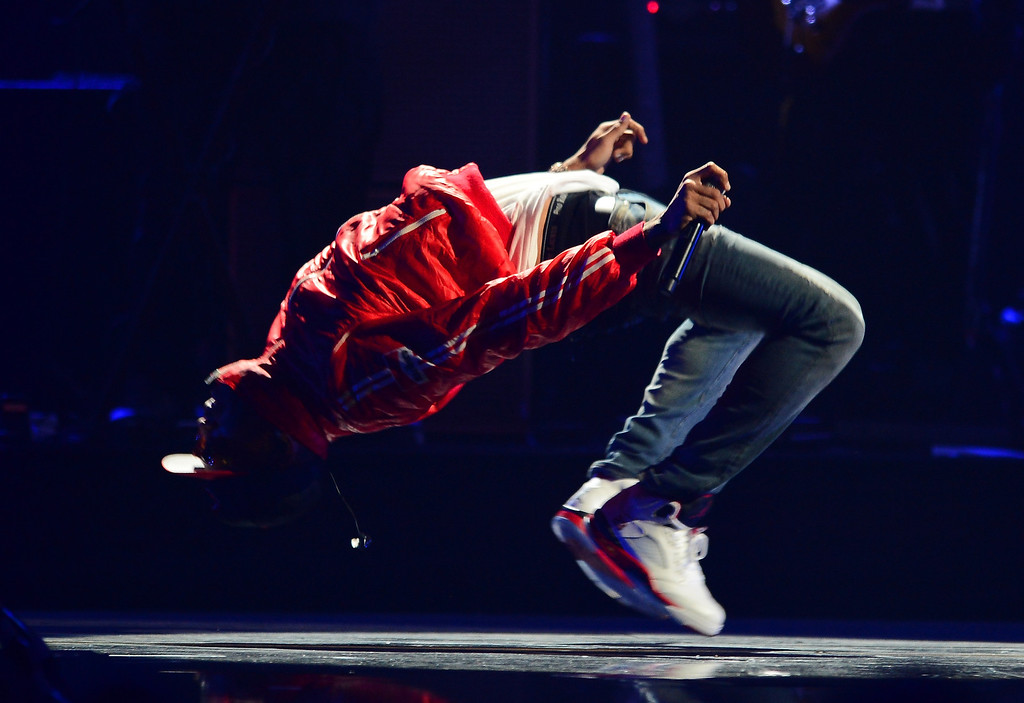 . Singer Chris Brown performs onstage during the iHeartRadio Music Festival at the MGM Grand Garden Arena on September 20, 2013 in Las Vegas, Nevada.  (Photo by Ethan Miller/Getty Images for Clear Channel)