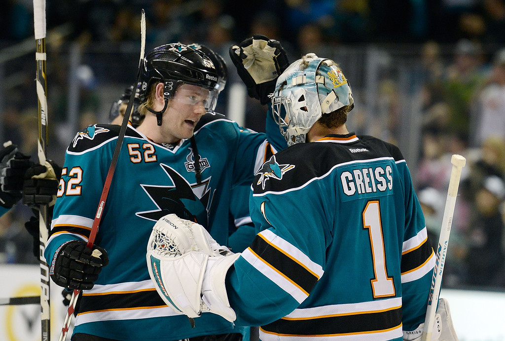 . SAN JOSE, CA - JANUARY 26:  Thomas Greiss #1 and Matthew Irwin #52 of the San Jose Sharks celebrate defeating the Colorado Avalanche 4-0 at HP Pavilion on January 26, 2013 in San Jose, California.  (Photo by Thearon W. Henderson/Getty Images)