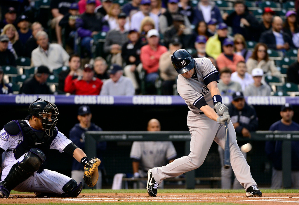 . DENVER, CO. - MAY 07: Jayson Nix (17) of the New York Yankees gets a base hit in the first inning against the Colorado Rockies May 7, 2013 at Coors Field. (Photo By John Leyba/The Denver Post)