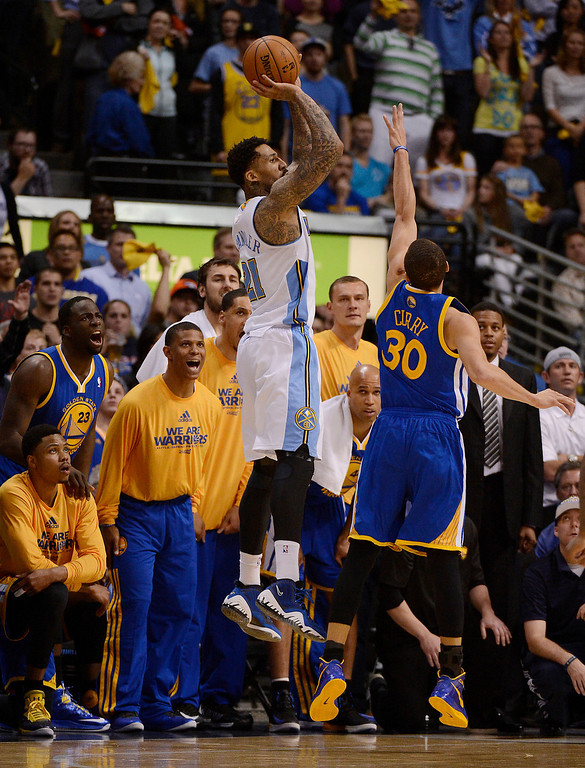 . Denver Nuggets shooting guard Wilson Chandler (21) puts up a shot over Golden State Warriors point guard Stephen Curry (30) in the fourth quarter. The Denver Nuggets took on the Golden State Warriors in Game 5 of the Western Conference First Round Series at the Pepsi Center in Denver, Colo. on April 30, 2013. (Photo by John Leyba/The Denver Post)