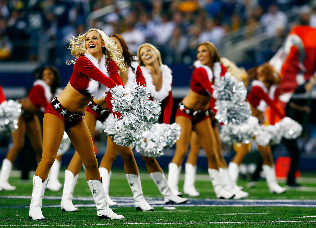 . Dallas Cowboys cheerleaders perform at halftime during a game against the Green Bay Packers at AT&T Stadium on December 15, 2013 in Arlington, Texas.  (Photo by Tom Pennington/Getty Images)