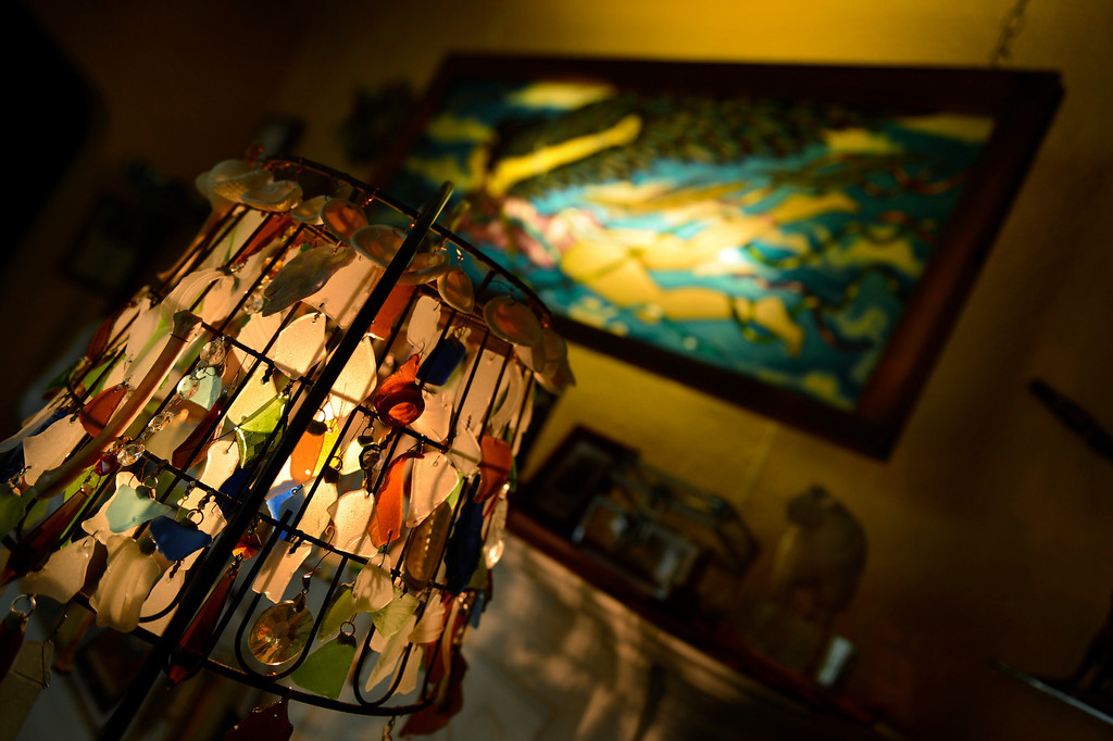 . Edgewater, CO. - January 28:  A sea glass chandelier with a painted glass piece The Flying Lady done by artist Dede LaRue in her home studio in Edgewater, Colorado. January 28, 2013. (Photo By Joe Amon / The Denver Post)