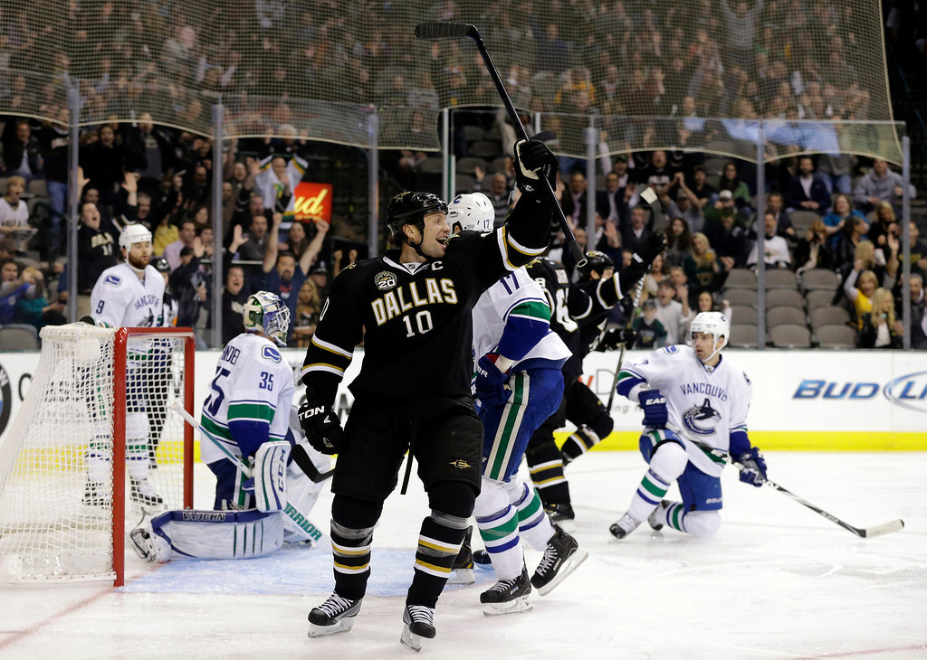 . Dallas Stars\' Brenden Morrow (10) celebrates a goal against the Vancouver Canucks scored by Jamie Benn in the first period of an NHL hockey game, Thursday, Feb. 21, 2013, in Dallas. (AP Photo/Tony Gutierrez)