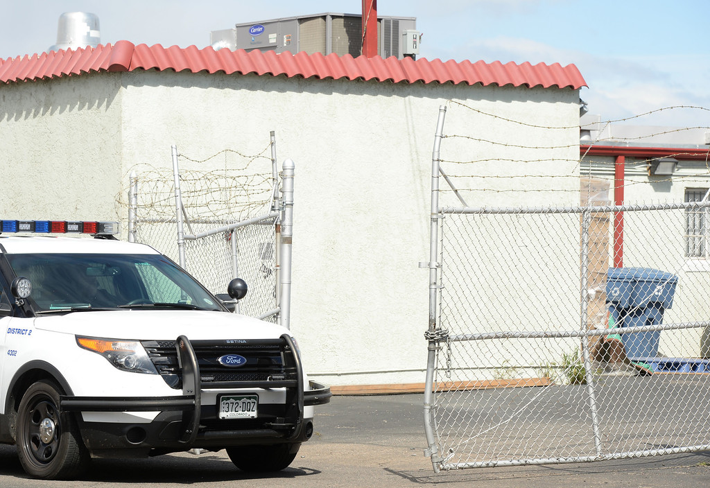 . Denver Police stay out front of a location that Drug Enforcement Agency officials raided earlier, at 4800 North Brighton Blvd. in Denver, April 30, 2014. The location is part of raids that when on through the morning on place tied to VIP Cannabis. (Photo by RJ Sangosti/The Denver Post)