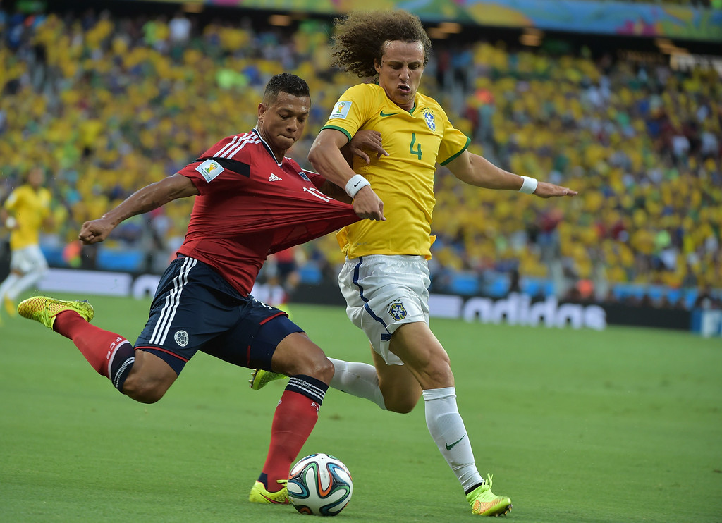 . Colombia\'s midfielder Fredy Guarin (L) vies with Brazil\'s defender David Luiz during the quarter-final football match between Brazil and Colombia at the Castelao Stadium in Fortaleza during the 2014 FIFA World Cup on July 4, 2014. GABRIEL BOUYS/AFP/Getty Images