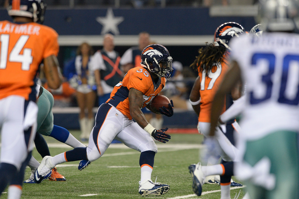 . ARLINGTON, TX - AUGUST 28: Denver Broncos running back Kapri Bibbs (35) hits a hole in the Dallas Cowboys defense to find the end zone during the third quarter August 28, 2014 at AT&T Stadium. (Photo by John Leyba/The Denver Post)