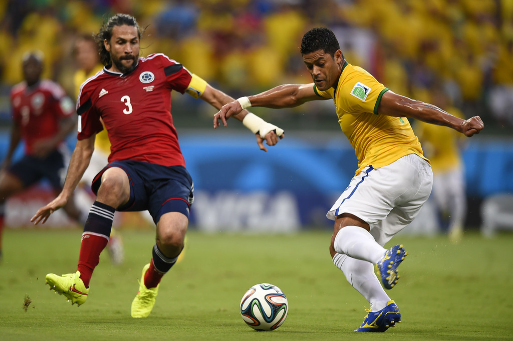 . Brazil\'s forward Hulk (R) vies with Colombia\'s defender and captain Mario Alberto Yepes during the quarter-final football match between Brazil and Colombia at the Castelao Stadium in Fortaleza during the 2014 FIFA World Cup on July 4, 2014. FABRICE COFFRINI/AFP/Getty Images