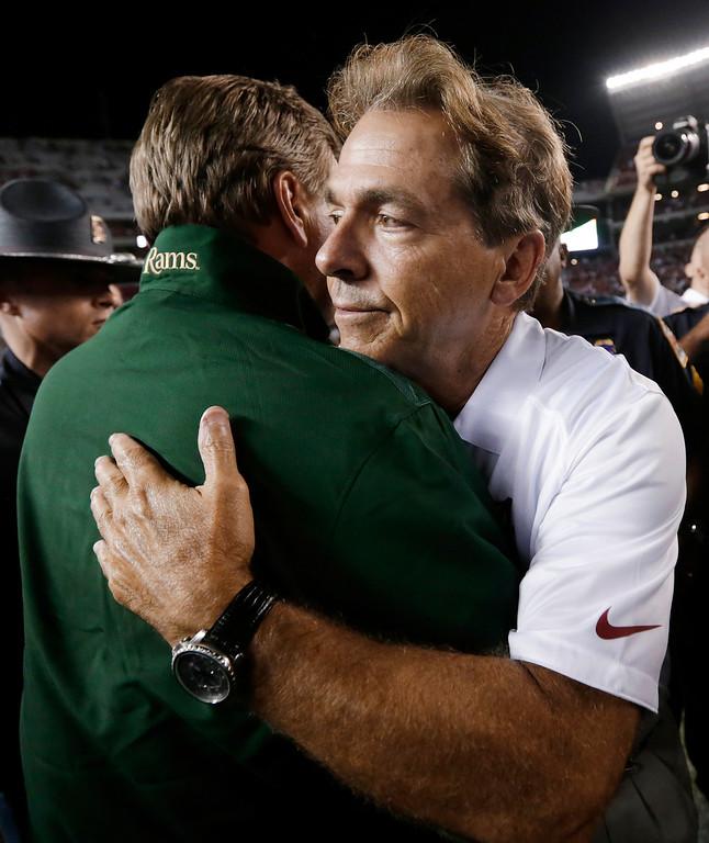 . Alabama coach Nick Saban, right, hugs Colorado State coach Jim McElwain following Alabama\'s 31-6 win in an NCAA college football game in Tuscaloosa, Ala., Saturday, Sept. 21, 2013. (AP Photo/Dave Martin)