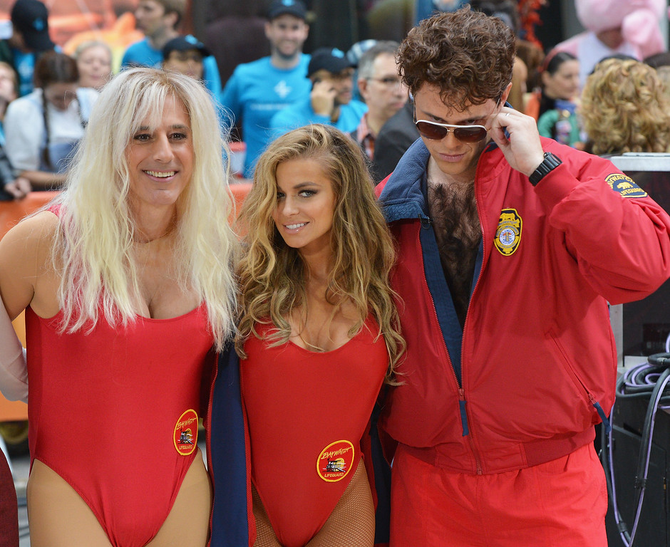 """. (L-R) Matt Lauer, Carmen Electra and Willie Geist, dressed as charaters from\'Baywatch\' attend NBC\'s \""""Today\"""" Halloween 2013 in Rockefeller Plaza on October 31, 2013 in New York City.  (Photo by Slaven Vlasic/Getty Images)"""
