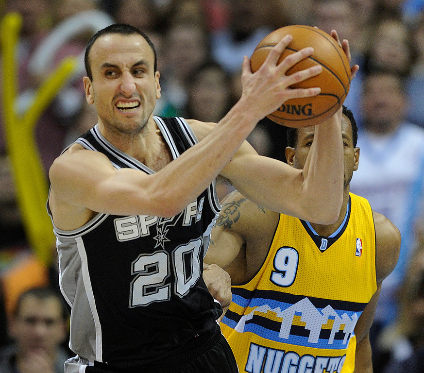 . Spurs guard Manu Ginobili (20) grabbed a rebound late in the second half. The Denver Nuggets defeated the San Antonio Spurs 112-106 at the Pepsi Center Tuesday night, December 18, 2012. Karl Gehring/The Denver Post