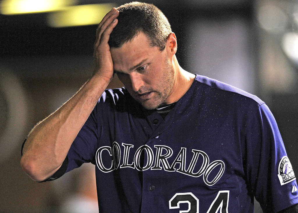 . Colorado Rockies relief pitcher Matt Belisle reacts in the dugout during the final inning of the team\'s 5-3 loss to the San Francisco Giants during a baseball game on Tuesday, Aug. 27, 2013, in Denver. (AP Photo/Jack Dempsey)