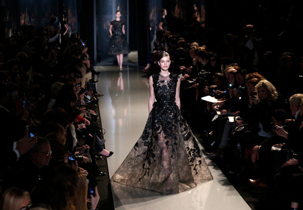 . A model wears a creation by Lebanese fashion designer Elie Saab for his Spring Summer 2013 Haute Couture fashion collection, presented in Paris, Wednesday, Jan.23, 2013. (AP Photo/Christophe Ena)