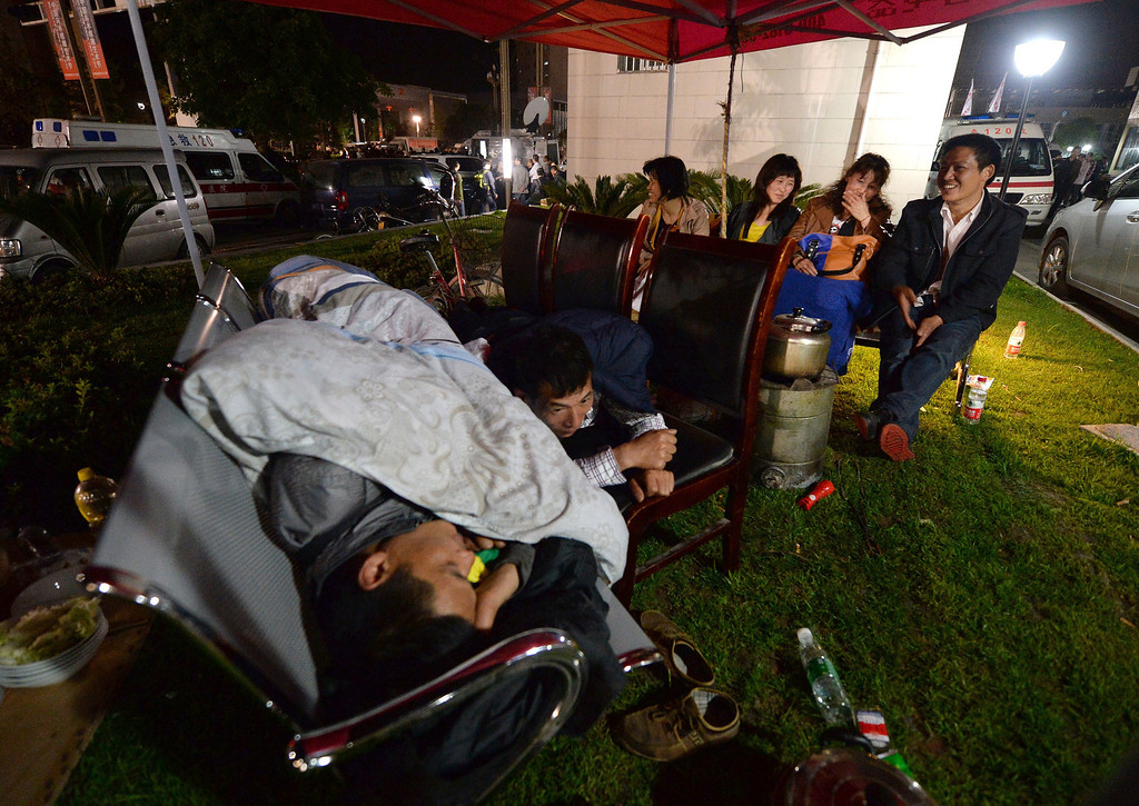 . Local residents sleep outside the Lushan People\'s hospital after a magnitude 7.0 earthquake hit the city of Ya\'an, in southwest China\'s Sichuan province on April 20, 2013. More than 150 people were killed and 5,700 injured when a strong earthquake hit a mountainous part of southwestern China on April 20, destroying thousands of homes and triggering landslides in an area devastated by a major tremor in 2008. MARK RALSTON/AFP/Getty Images