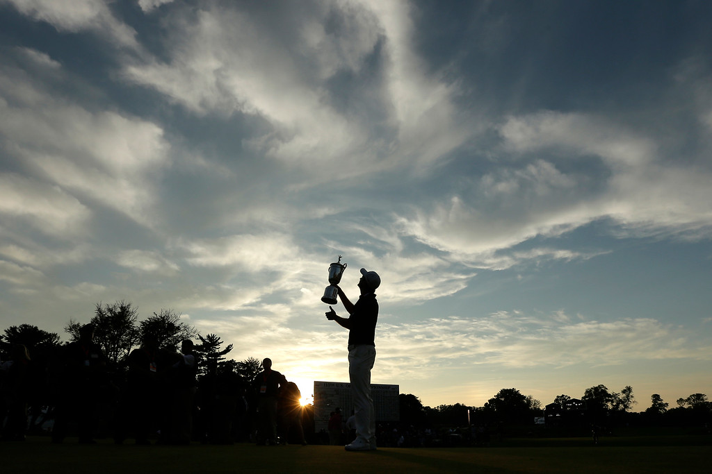 . Justin Rose, of England, poses with the trophy after winning the U.S. Open golf tournament at Merion Golf Club, Sunday, June 16, 2013, in Ardmore, Pa. (AP Photo/Charlie Riedel)
