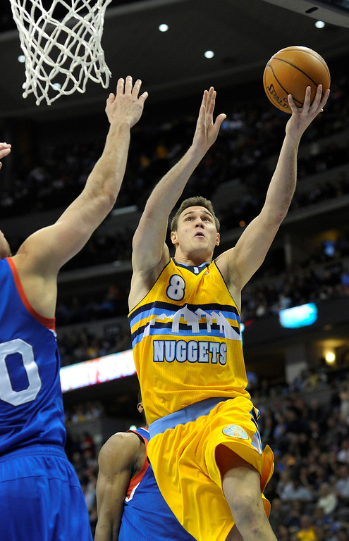 . DENVER, CO. - MARCH 21: Danilo Gallinari (8) of the Denver Nuggets drove to basket in the second half. The Denver Nuggets defeated the Philadelphia 76ers 101-100 Thursday night, March 21, 2013 at the Pepsi Center. The Nuggets are on a 14-game record winning streak that is a team record. (Photo By Karl Gehring/The Denver Post)