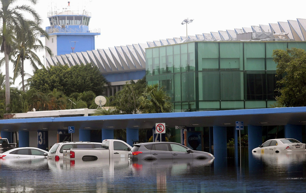 . Picture of the airport of Acapulco, Guerrero state, Mexico, on September 17, 2013 flooded by heavy rains that have been hitting the country. Mexican authorities scrambled Tuesday to launch an air lift to evacuate tens of thousands of tourists stranded amid floods in the resort of Acapulco following a pair of deadly storms. At least 48 people were killed and thousands evacuated from towns on the Pacific and Gulf of Mexico coasts over the weekend as Tropical Storm Manuel and downgraded Hurricane Ingrid set off landslides and floods that damaged bridges, roads and homes.  Pedro PARDO/AFP/Getty Images