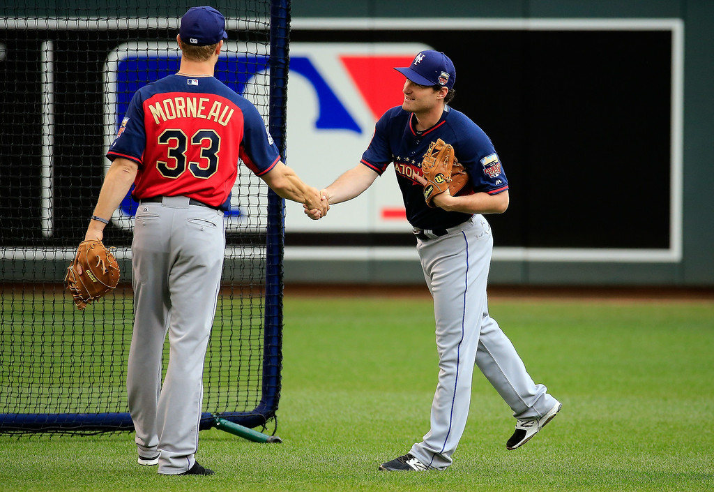 . Daniel Murphy of the New York Mets meets Justin Morneau of the Colorado Rockies during the Gatorade All-Star Workout Day at Target Field on July 14, 2014 in Minneapolis, Minnesota.  (Photo by Rob Carr/Getty Images)