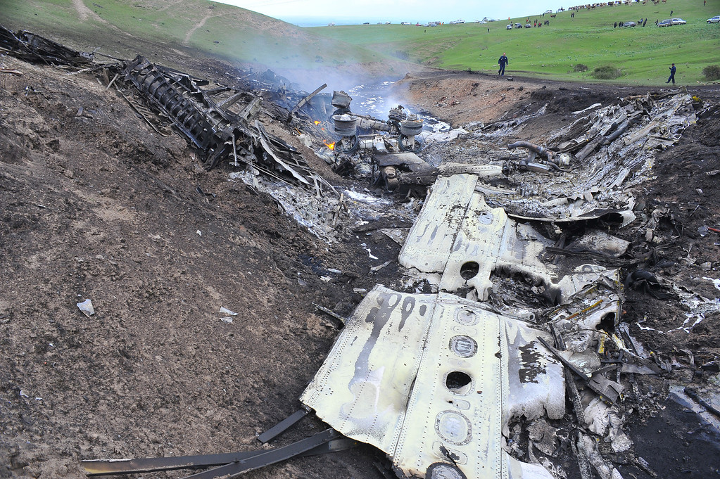 . The debris of a crashed US KC-135 Stratotanker plane are seen on a hill near the villages of Chorgolo and Cholok-Aryk, 180 km from the Kyrgyzstan�s capital Bishkek, on May 3, 2013.  AFP PHOTO/ SABYR AILCHIYEV/AFP/Getty Images