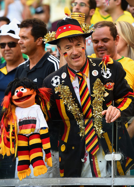 . A Germany fan poses with an Ernie puppet during the 2014 FIFA World Cup Brazil Group G match between Germany and Portugal at Arena Fonte Nova on June 16, 2014 in Salvador, Brazil.  (Photo by Stu Forster/Getty Images)