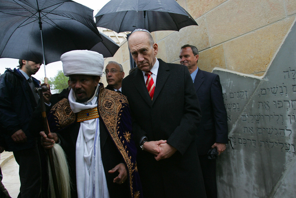 . JERUSALEM, -: Israeli Prime Minister Ehud Olmert (R) listens as an Ethiopian Jewish Kes, or religious leader, recites prayers at a ceremony 14 March 2007 at Mt. Hertzl in Jerusalem. More than two decades after thousands of the community were brought to Israel in dramatic and clandestine operations, the Jewish State dedicated the monument commemorating the 4,000 Ethiopian Jews who perished on journey to the Holy Land. DAVID SILVERMAN/AFP/Getty Images