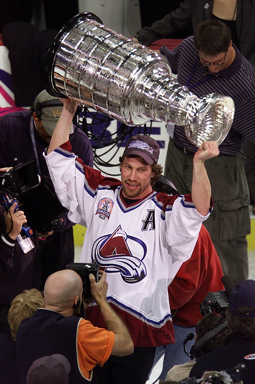 . Peter Forsberg #21 of the Colorado Avalanche raises the Stanley Cup in Denver, Coloardo after losing his spleen earlier, during the Western Conference Finals series, in pursuit of the 2001 NHL Stanley Cup Championship.  Brian Bahr/ALLSPORT