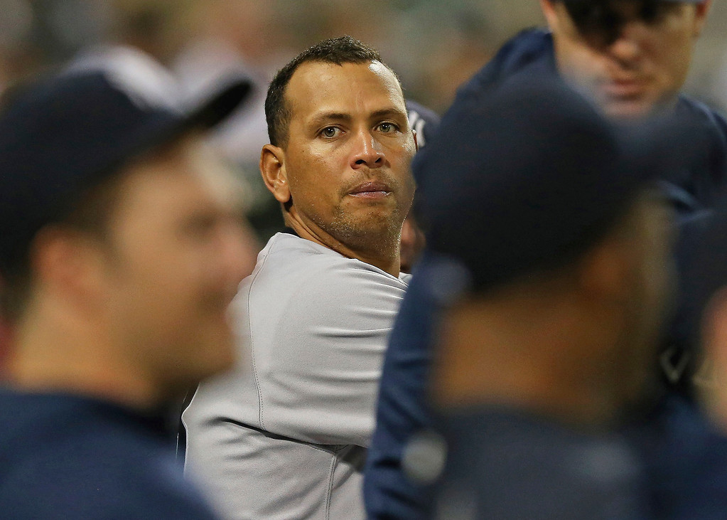 . Alex Rodriguez #13 of the New York Yankees talks to teammates in the dugout during a game against the Chicago White Sox at U.S. Cellular Field on August 5, 2013 in Chicago, Illinois.  (Photo by Jonathan Daniel/Getty Images)