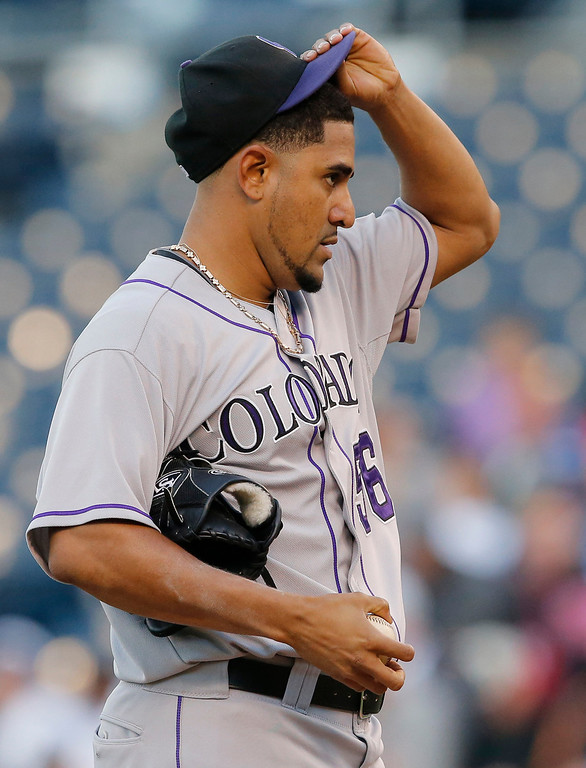 . Colorado Rockies starting pitcher Franklin Morales adjusts his hat after giving up a hit during the first inning of a baseball game against the Kansas City Royals at Kauffman Stadium in Kansas City, Mo., Tuesday, May 13, 2014. (AP Photo/Orlin Wagner)