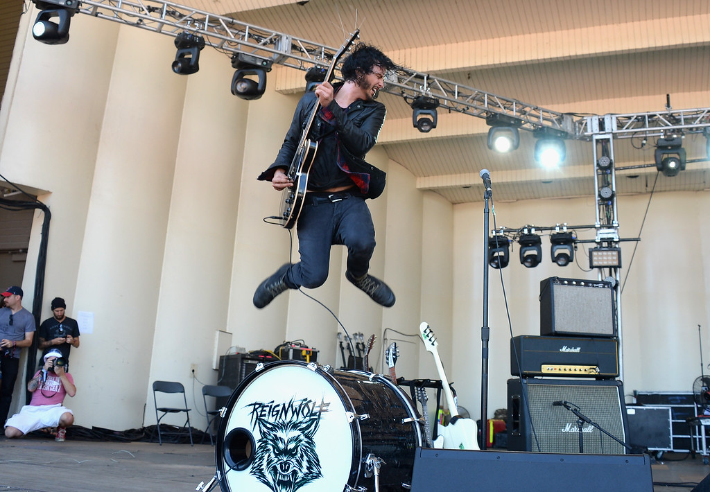 . CHICAGO, IL - AUGUST 03:  Jordan Cook of Reignwolf performs during Lollapalooza 2013 at Grant Park on August 3, 2013 in Chicago, Illinois.  (Photo by Theo Wargo/Getty Images)