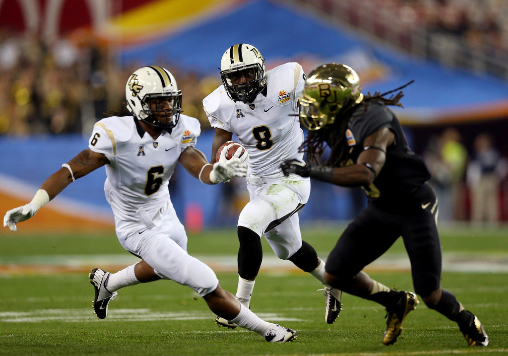 . GLENDALE, AZ - JANUARY 01:  Running back Storm Johnson #8 of the UCF Knights carries the ball against the Baylor Bears during the Tostitos Fiesta Bowl at University of Phoenix Stadium on January 1, 2014 in Glendale, Arizona.  (Photo by Ronald Martinez/Getty Images)