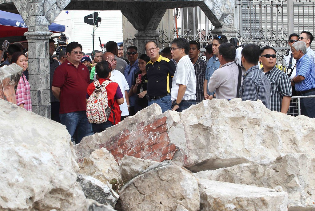 . In this handout photograph released by the Malacanang Photo Bureau, Philippine President Benigno Aquino (C, in black/yellow shirt) visits the earthquake-ruined Basilica Minore del Santo Nino church at Cebu City, central Philippines, on October 16, 2013. AFP PHOTO/RYAN LIM/MALACANANG PHOTO BUREAU/AFP/Getty Images