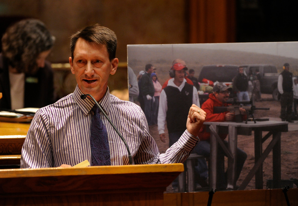 . DENVER, CO. - MARCH 8: Senator Greg Brophy (R-Wray) displayed a photograph of lobbyist Adam Eichberg shooting watermelons at Brophy\'s farm with an AR-10 rifle. The Colorado Senate continued to debate various gun control measures Friday night, March 8, 2013. (Photo By Karl Gehring/The Denver Post)