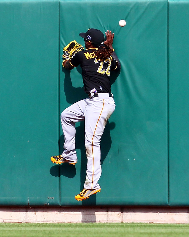 . ST LOUIS, MO - OCTOBER 04:  Andrew McCutchen #22 of the Pittsburgh Pirates is unable to make a catch on a ball hit by Matt Adams #53 of the St. Louis Cardinals in the ninth inning during Game Two of the National League Division Series at Busch Stadium on October 4, 2013 in St Louis, Missouri.  (Photo by Dilip Vishwanat/Getty Images)